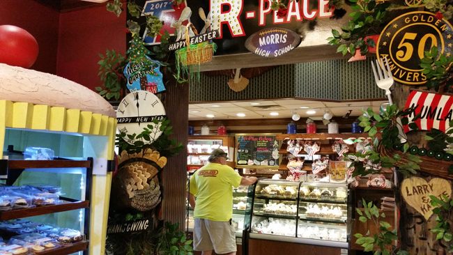 R-Place Family Eatery-Signs-Customer at Bakery CaseJI.jpg