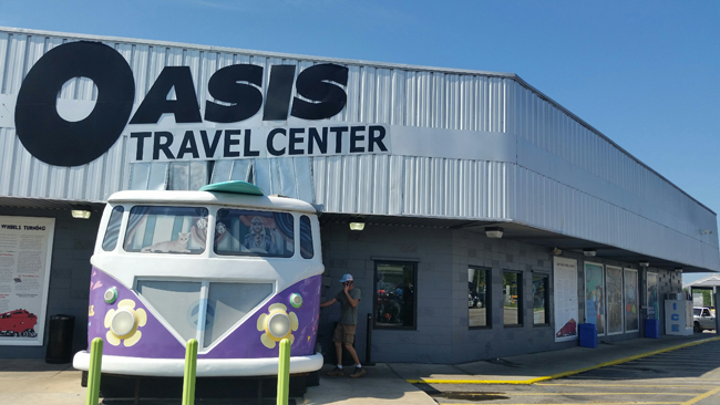 Oasis Travel Center-VW Bug Hooked onto Front of LocationJI.jpg