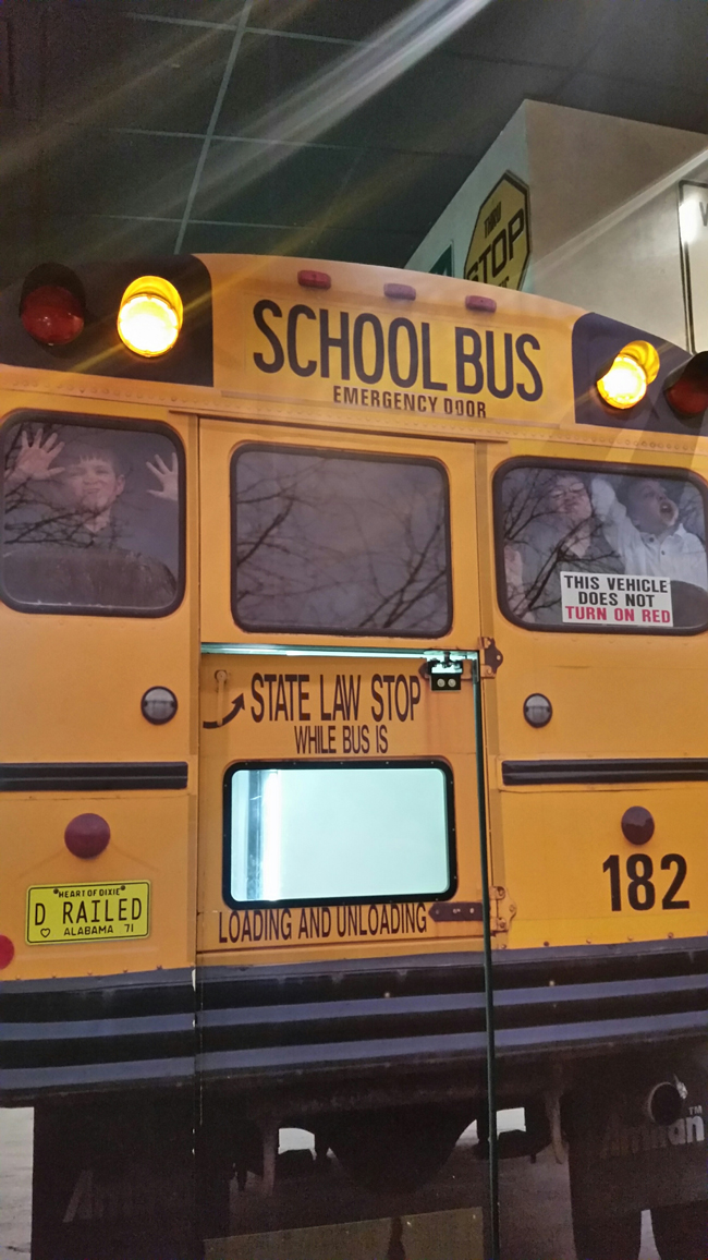 Oasis Travel Center-Back of School Bus with Kids in WindowJI.jpg