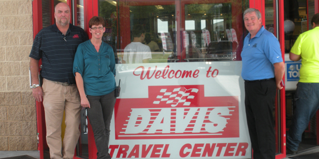 DavisTravelCenter-BillDecker&Staff-WelcomeSignJI.jpg
